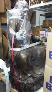 400 lb. Bronze Buddha gets ready for trip to China