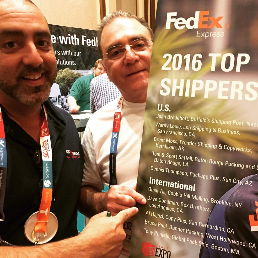 Coby and Dave getting Top Shipper Award from Fedex