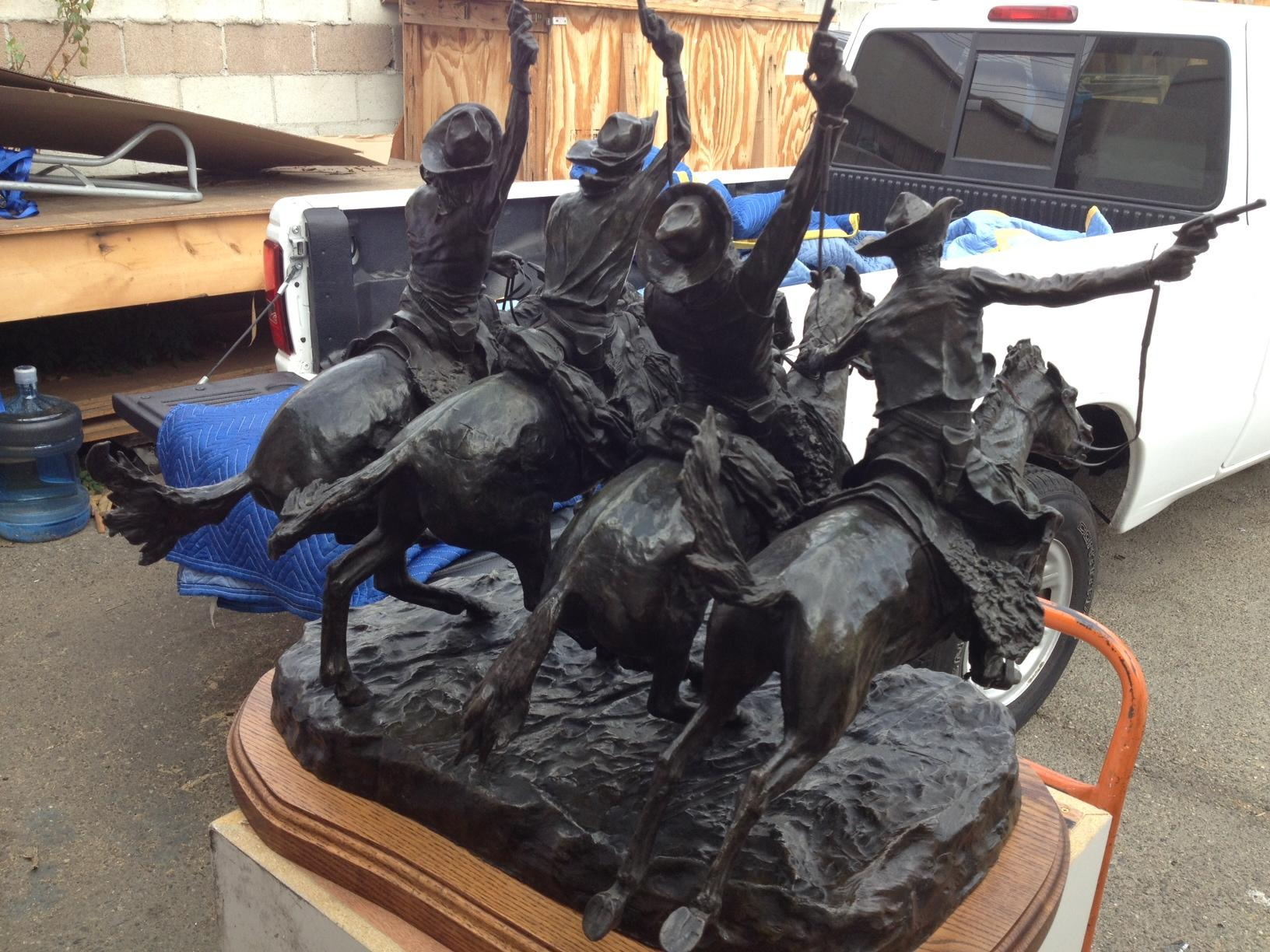 "<a href=""/image/image-galleries/shipping-frederic-remington-bronze/picking-remington-bronze"">picking up  a Remington bronze</a>"