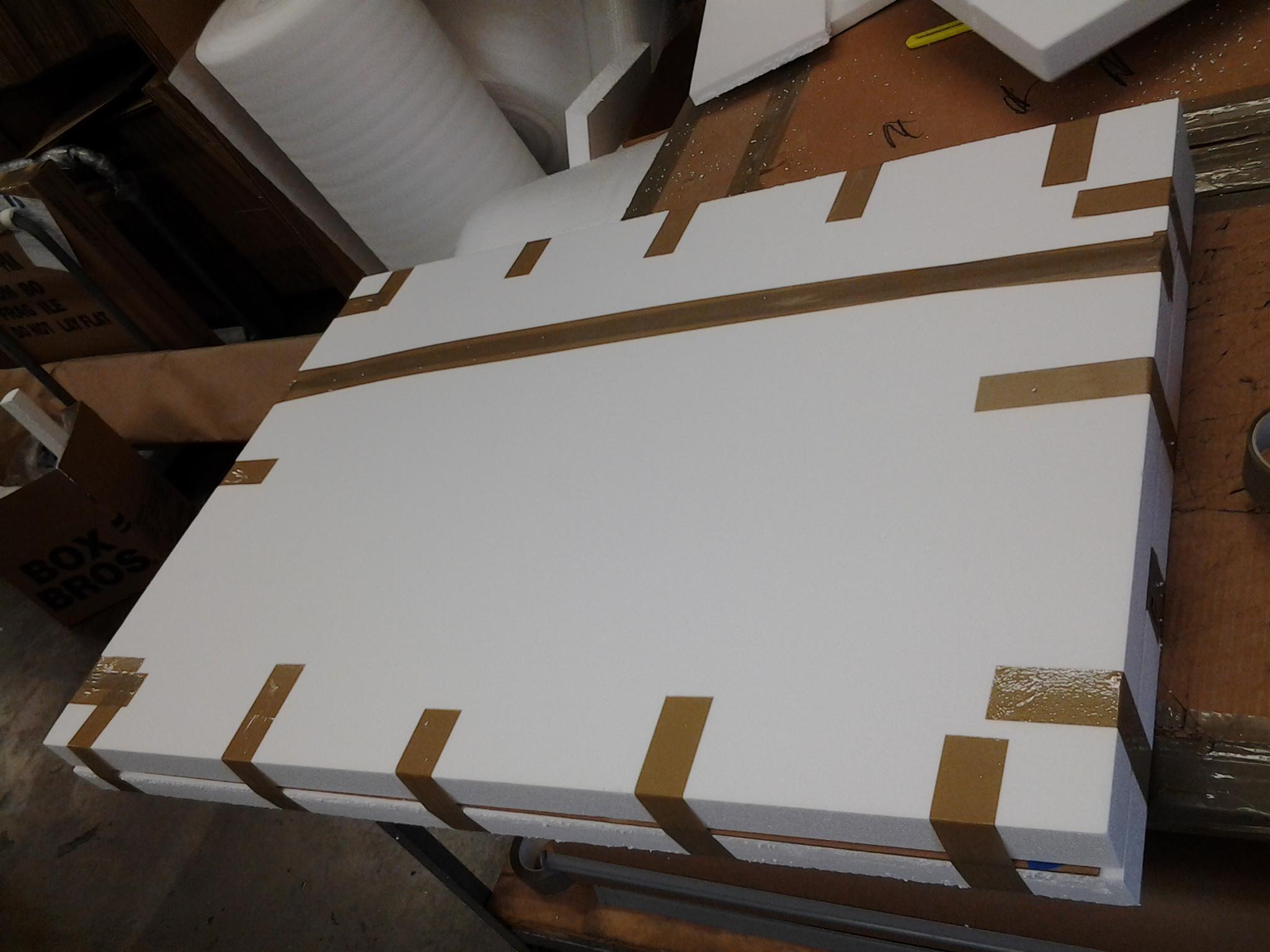 """<a href=""""/image/packing-unframed-art-4"""">Packing Unframed Art 4</a>"""